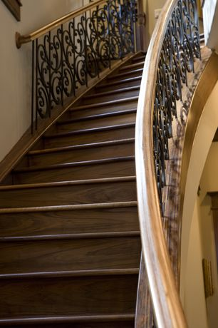 Traditional Staircase with Hardwood floors, curved staircase, Standard height