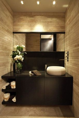 Contemporary Powder Room with Whitehaus collection isabella round bathroom sink with center drain, limestone tile floors