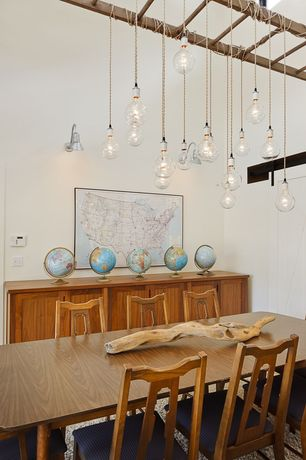 Contemporary Dining Room with Standard height, Barn door, Pendant light, Built-in bookshelf, Exposed beam, Wall sconce