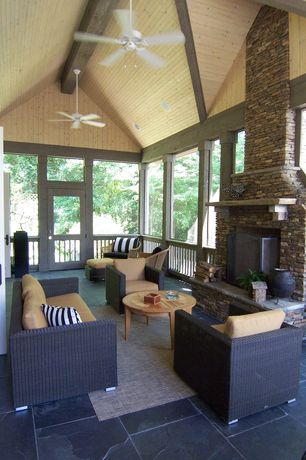 Modern Porch with French doors, Vaulted wood ceiling, Transom window, Round teak coffee table, Outdoor area rug, Sunroom