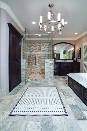 Traditional Master Bathroom with specialty door, Simple marble counters, Handheld showerhead, Custom Frameless Shower