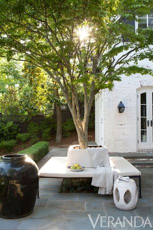Traditional Patio with Fence, exterior stone floors, Casement, French doors