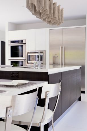 Contemporary Kitchen with Kitchen island, Flush, limestone tile floors, Corian counters, European Cabinets, L-shaped