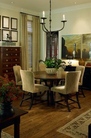 Traditional Dining Room with Hardwood floors, Standard height, Chandelier, Built-in bookshelf, can lights, Crown molding