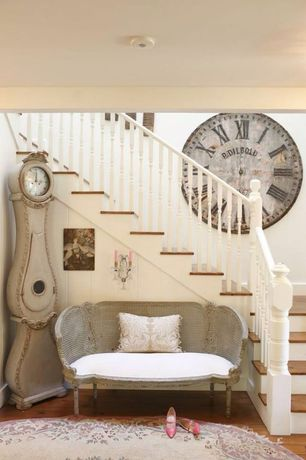 Traditional Entryway with can lights, Gustavian wicker love seat, High ceiling, Hardwood floors, Painted stair risers