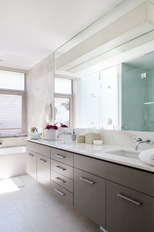 Contemporary Master Bathroom with Double sink, frameless showerdoor, can lights, Undermount sink, drop in bathtub, Bathtub