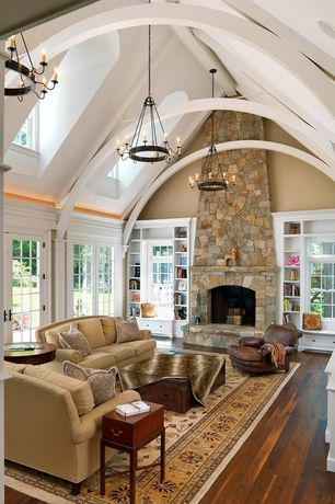 Traditional Living Room with Cathedral ceiling, Restoration Hardware New Parisian Leather Chair, Window seat, stone fireplace