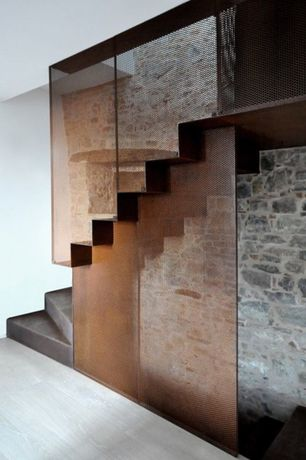 Modern Entryway with Stone Veneer, Corten Flat Sheet, Laminate floors