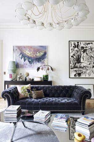 Contemporary Living Room with Hardwood floors, Anthropologie Velvet Lyre Chesterfield Sofa, Crown molding, Chandelier