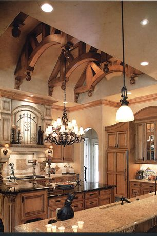 Mediterranean Kitchen with Hinkley Lighting Plantation 21 Light Chandelier, Exposed beam, Concrete floors, Crown molding