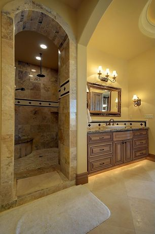 Mediterranean Master Bathroom with Arizona Tile Amalfi Noce Porcelain Tile, Rain shower, Cathedral ceiling, Wall sconce