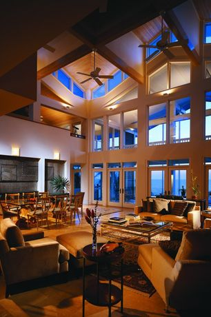 Modern Living Room with Transom window, Loft, Cathedral ceiling, picture window, terracotta tile floors, Exposed beam