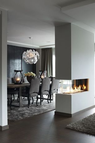 Contemporary Dining Room with Standard height, 3 sided fireplace, Maxim lighting 10 light comet large pendant, Chandelier