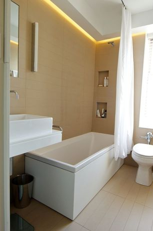 Contemporary Master Bathroom with Master bathroom, Vinyl floors, Freestanding, tiled wall showerbath, Vessel sink