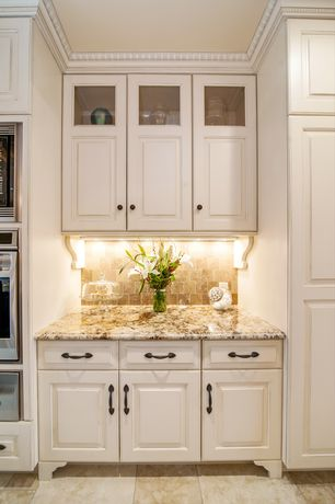 Traditional Kitchen with Complex granite counters, Limestone Tile, Glass panel, Crown molding, Stone Tile, One-wall, Flush