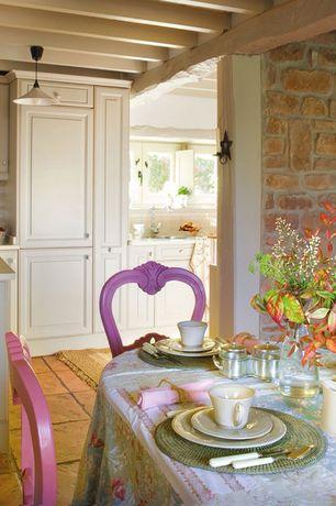 Rustic Dining Room with Standard height, sandstone tile floors, Interior stone wall, Exposed beam, stone tile floors, Paint