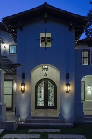 Mediterranean Front Door with Outdoor chandelier, Double wrought iron and glass doors, Outdoor sconces