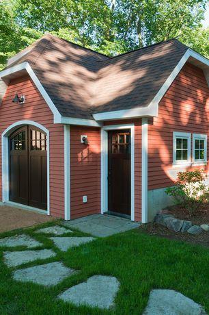 Craftsman Garage with simple granite floors, Barn door, Glass panel door, Wall sconce