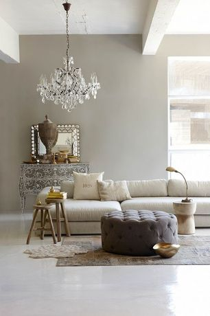Contemporary Living Room with Concrete floors, Chandelier, Exposed beam