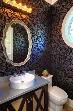 Eclectic Powder Room with Powder room, Crown molding, Hardwood floors, Vessel sink, interior wallpaper, Flush, specialty door