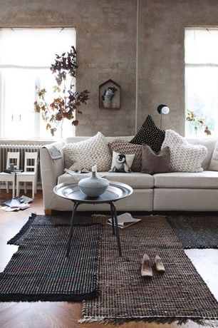 Rustic Living Room with Wall sconce, Exposed brick wall, Sectional sofa, Runner rug, Casement window, Hardwood floors