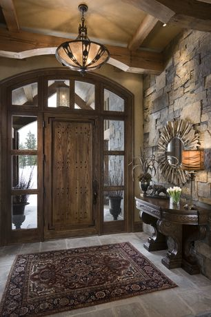 Rustic Entryway with Tiffany shotgun shell inverted pendant, Transom window, quartz floors, Grand palais console table