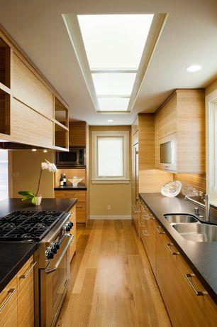 Contemporary Kitchen with gas range, full backsplash, Skylight, Corian counters, Paint, European Cabinets, Multiple Sinks