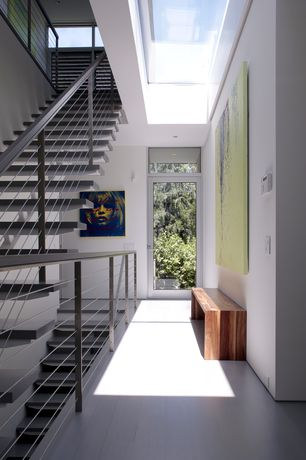 Contemporary Staircase with Transom window, can lights, Concrete floors, French doors, Metal staircase, Skylight