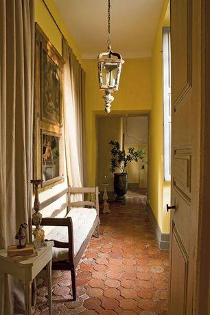 Mediterranean Hallway with specialty door, Interlocking Pavers, Pendant light, Standard height