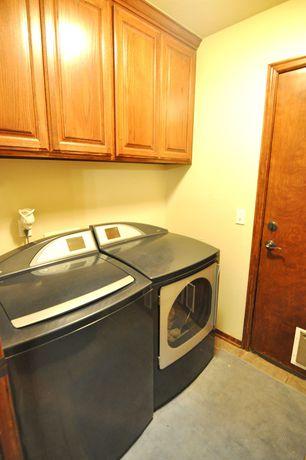 Traditional Laundry Room with Standard height, laundry sink, Built-in bookshelf, Undermount sink, limestone floors, flat door