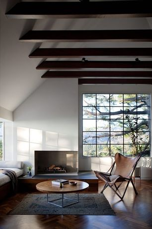 Contemporary Living Room with Exposed beam, Hardwood floors, Fireplace, Standard height, flush light, Casement