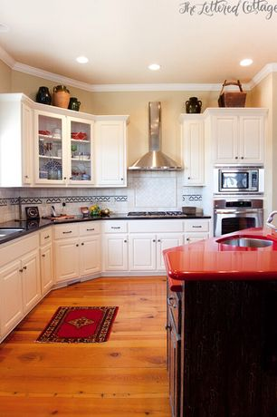Traditional Kitchen with Glass panel, Crown molding, Soapstone counters, L-shaped, Stone Tile, Limestone Tile, Inset cabinets