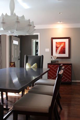 Contemporary Dining Room with Hardwood floors, can lights, Chandelier, Standard height, Crown molding