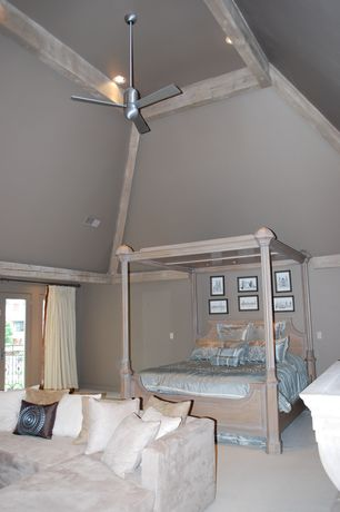 Traditional Master Bedroom with can lights, Carpet, Paint, Exposed beam, French doors, High ceiling, Ceiling fan