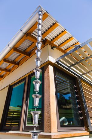 Contemporary Exterior of Home with Aluminum Flared Cups Rain Chain