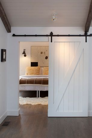 Contemporary Guest Bedroom with bedroom reading light, Standard height, Beadboard ceiling, Paint, Laminate floors, Barn door
