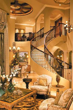 Traditional Staircase with High ceiling, travertine tile floors, Chandelier, Exposed beam, Columns