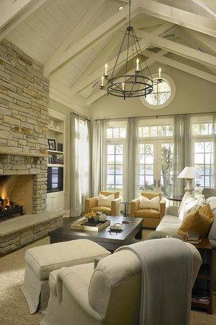 Contemporary Living Room with can lights, Iron double ring chandelier, High ceiling, Exposed beam, picture window, Fireplace