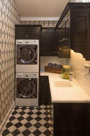 Contemporary Laundry Room with Standard height, interior wallpaper, stone tile floors, Undermount sink, laundry sink