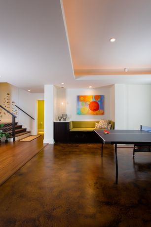 Contemporary Game Room with High ceiling, Pendant light, Concrete floors, can lights
