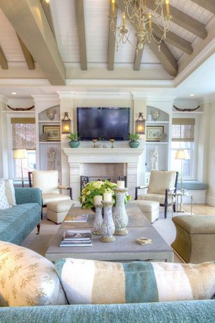 Cottage Living Room with Wood mantel, Distressed ceramic candle holders, Built-in bookshelf, Hardwood floors, Exposed beam