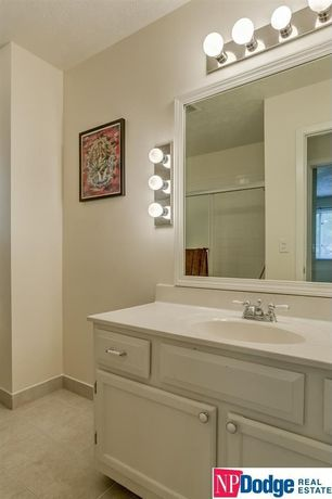 Traditional 3/4 Bathroom with Undermount sink, limestone tile floors, Raised panel, Corian counters, Inset cabinets