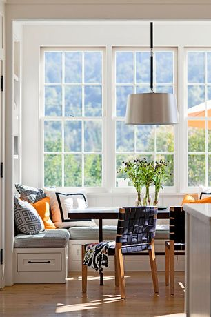 Contemporary Dining Room with Pendant light, double-hung window, Crown molding, Hardwood floors, Standard height, Window seat