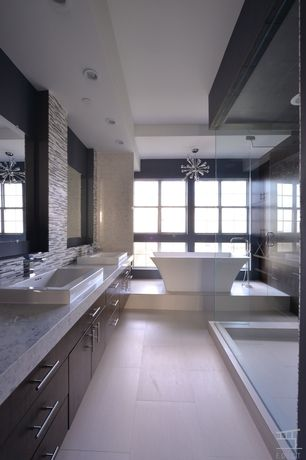 Contemporary Master Bathroom with Chandelier, European Cabinets, stone tile floors, Double sink, Complex marble counters