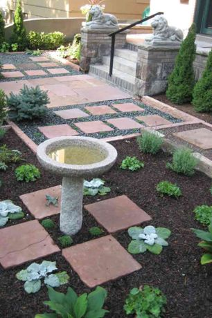 Traditional Landscape/Yard with exterior stone floors, Fence, Bird bath, Pathway