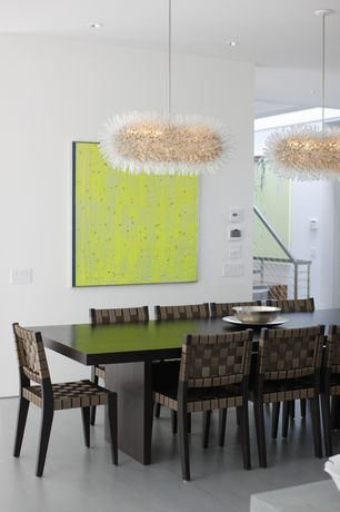 Contemporary Dining Room with High ceiling, Pendant light, Concrete floors