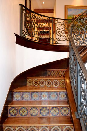 Eclectic Staircase with Hand painted ceramic tile, High ceiling, Hardwood floors