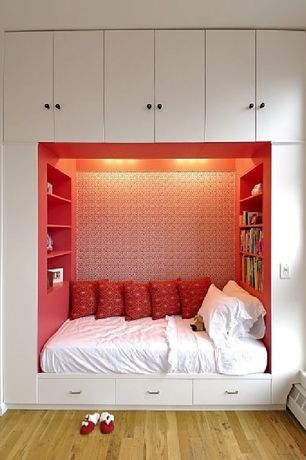 Cottage Kids Bedroom with Hardwood floors, Built-in bookshelf