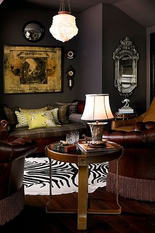 Eclectic Living Room with eCowhides Zebra Cowhide Rug, Table lamo, Side table, Leather armchair, Table lamp, Pendant light