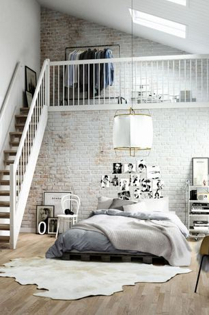 Contemporary Master Bedroom with Animal hide rug, Skylight, Natural light, interior brick, High ceiling, Pendant light, Loft